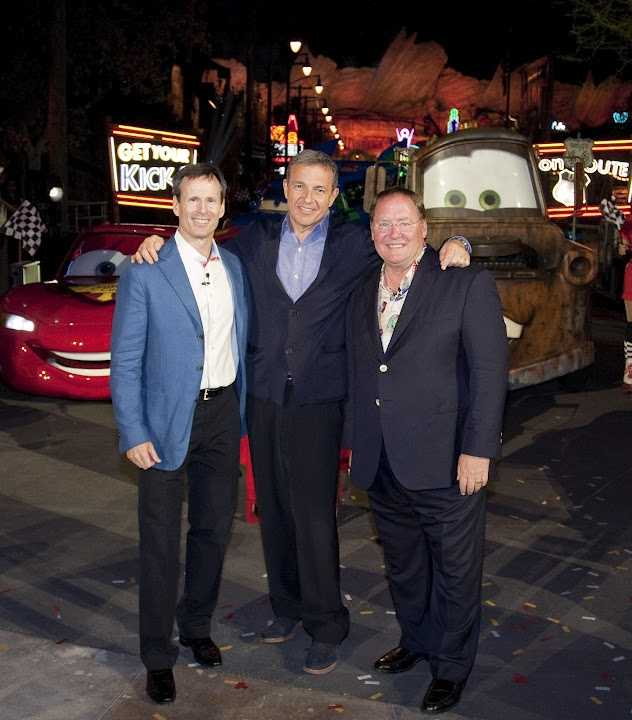 Tom Staggs, Chairman of Walt Disney Parks and Resorts, Robert A. Iger, Chairman and CEO of The Walt Disney Co. and John Lasseter, Chief Creative Officer of Walt Disney and Pixar Animation Studio, and Principal Creative Advisor for Walt Disney Imagineering, pose following the gala opening of Cars Land at Disney California Adventure park at Disneyland Resort in Anaheim, Calif.