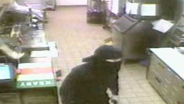 Robber caught on camera holding up Dunkin Donuts