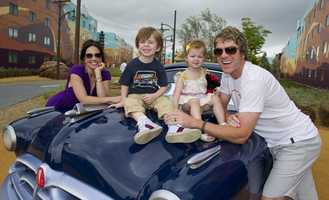 """Rascal Flatts guitarist and vocalist Joe Don Rooney and his family checked out the new Cars area of the Art of Animation Resort.  Rooney's children Jagger and Rocky sang dad's hit song """"Life is a Highway"""" while posing for the picture with mom Tiffany."""