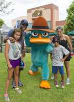 Darius Rucker visited Disney's Hollywood Studios with his family June 20.  Rucker's son Jack and daughters Dani and Cary helped to fight some crime with secret agent Agent P from Phineas and Ferb.