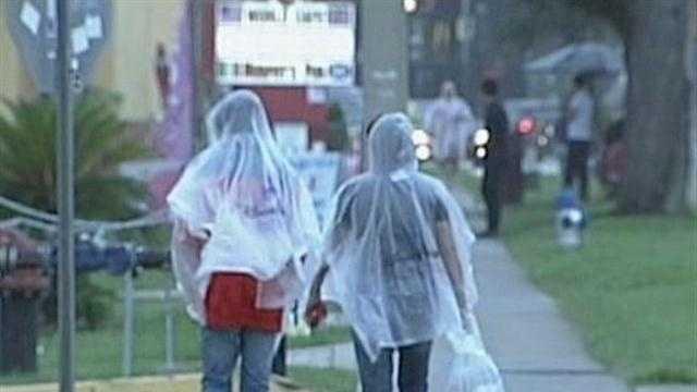 Tourists trade flip-flops for rain gear