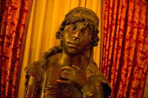 There are several French bronze statues in the lobby, including a few by 19th-century artist Moreau.