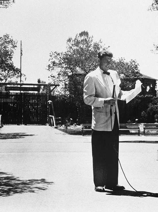 Actor and television star Ronald Reagan practiced his part for the opening of Disneyland.  He is shown here outside Frontierland.