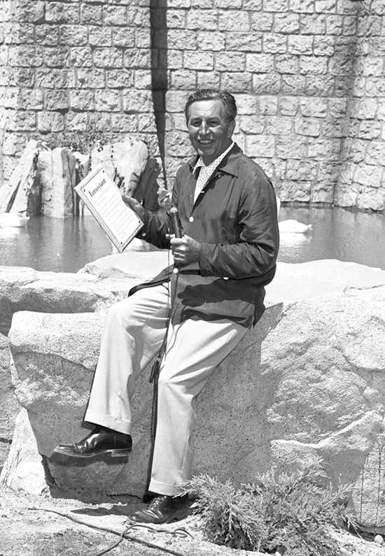 A smiling Walt Disney practiced his speech for Fantasyland at Sleeping Beauty's castle.
