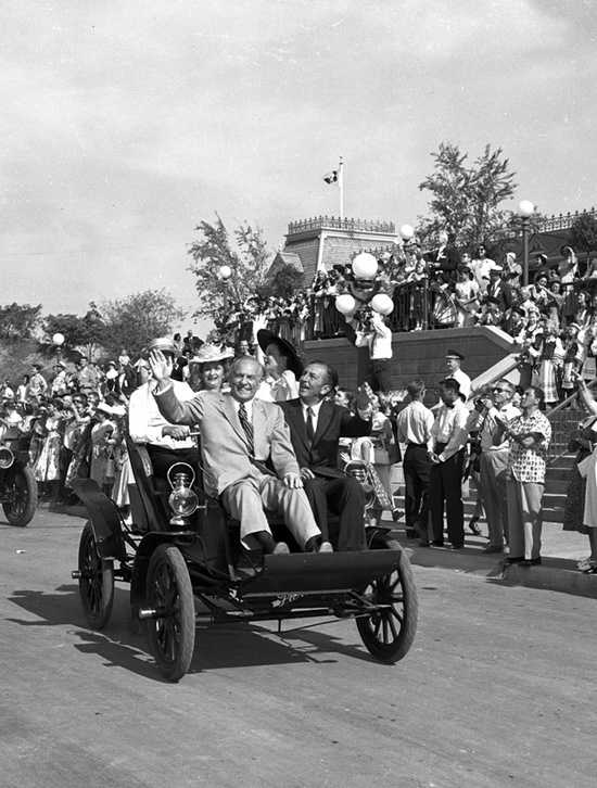 Walt Disney and California governor Goodwin Knight right down Main Street, U.S.A. during the dedication.