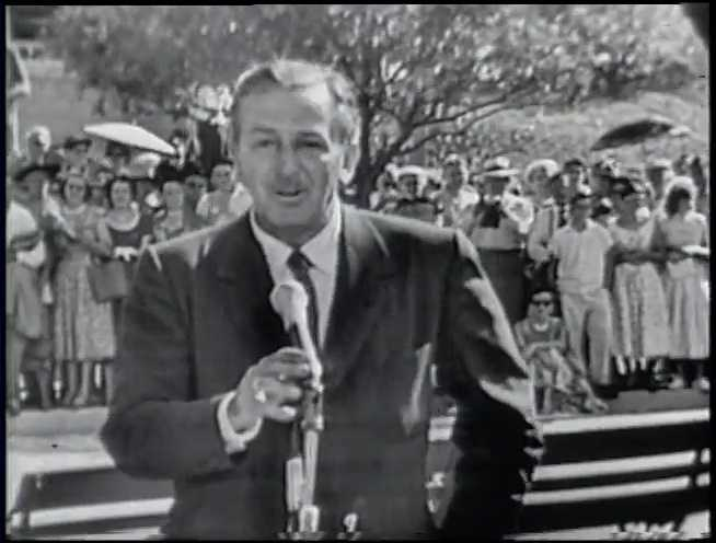 Walt Disney speaks to the crowd at the opening of Disneyland in Anaheim, California.