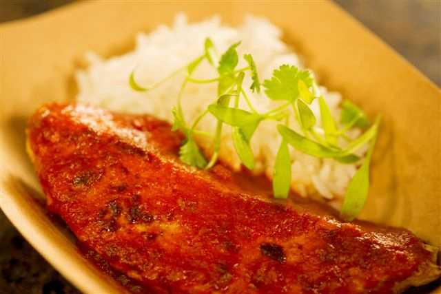 The Terra Marketplace offers vegan menu items including Trick'n Chick'n Curry with Basmati Rice and Chili Colorado with chips and cashew cheese.