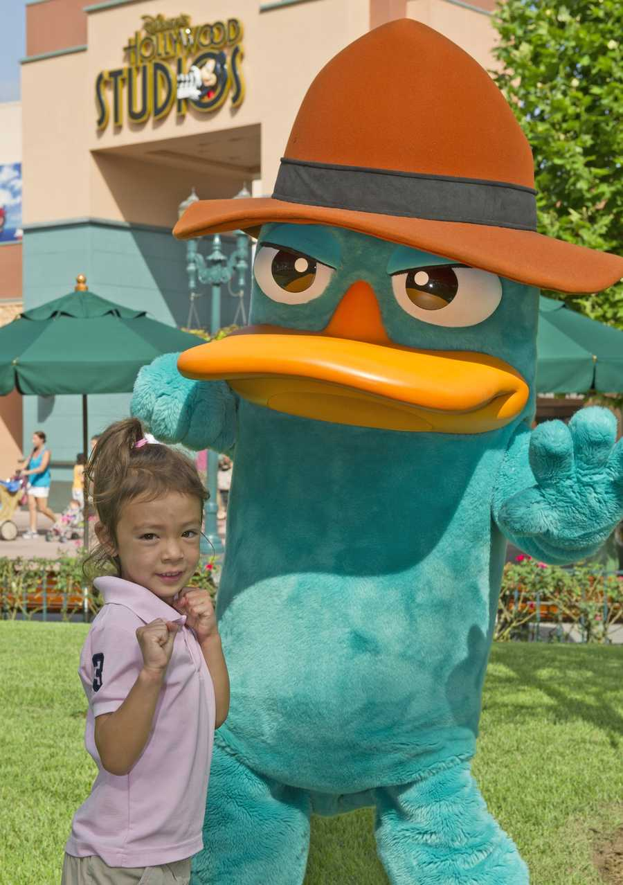 """Aubrey Anderson-Emmons, 5, who plays Lily on """"Modern Family"""" visited Disney's Hollywood Studios on July 20.  She hung out with Agent P from the Disney Channel show """"Phineas & Ferb""""."""