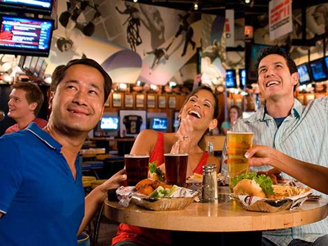 Further down on the boardwalk, stop in to catch the game -- any game -- at the ESPN Club. This lounge's video wall shows 30 different program feeds and every satellite sports package available.