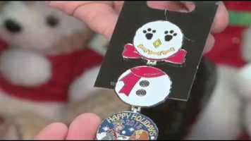 Holiday pin unfolds to make snowman.
