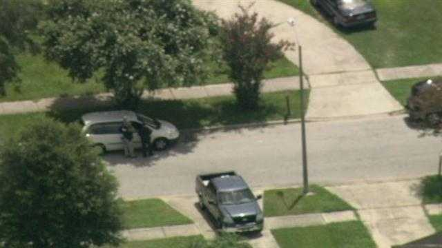 Police surrounded a home in Orlando where a man barricaded himself Thursday.