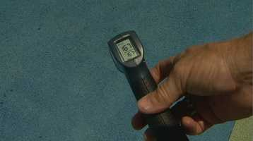 According to an infrared thermometer, the playground's tire crushed surface read 167 degrees.