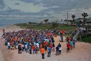 A memorial on Flagler Beach on Sunday night drew hundreds of people mourning the deaths of two local teenagers killed in a crash on Interstate 95.