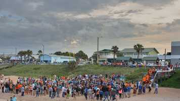 They filled the beach near the Flagler Pier to pay tribute to 18-year-old Lane Burnsed, who was the son of a Flagler County fire captain, and 17-year-old Meredith Smith, the daughter of Flagler Beach's public works director.