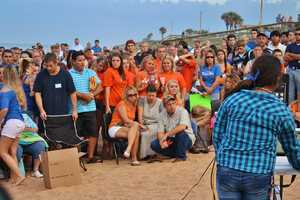 The crowd was encouraged to wear the teens' favorite colors, orange and blue.
