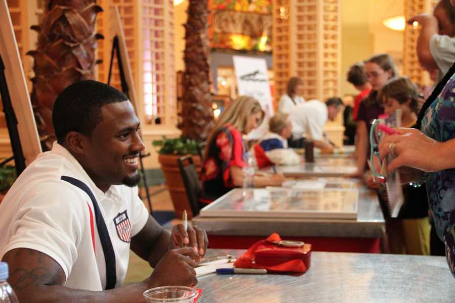 David Oliver is all smiles for fans at the WDW Swan and Dolphin Hotel before the 2012 opening ceremonies.