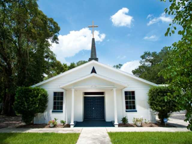 The St. Lawrence AME Church of Eatonville, Florida was founded in 1881 and is older than the Town of Eatonville. It was named after Lewis Lawrence, who donated the land on which the church was built. Pictured here is the present building, built in 1974 on the original church land. Mounted on the walls are one-of-a-kind paintings, which were originally housed in the earlier church.