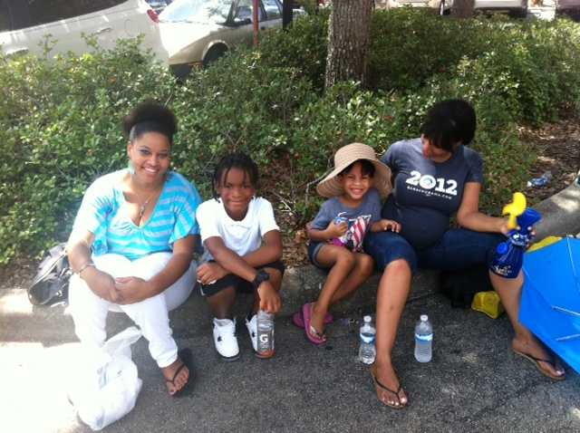 Families wait in line for President Obama. Some waited all morning in the heat.