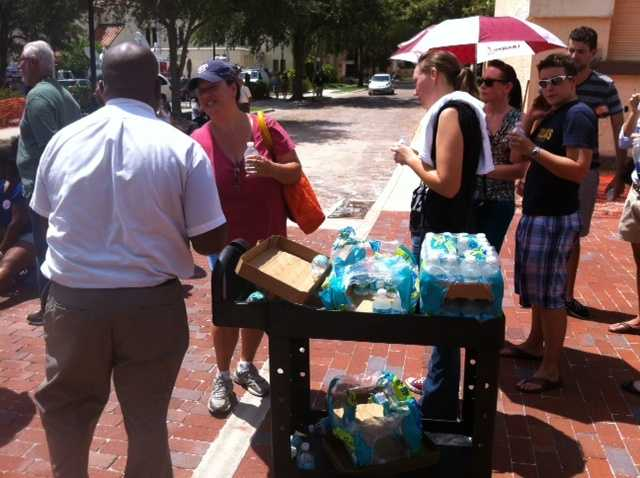 Rollins College is passing out water, because the heat is an issue for many people waiting in line.  Medics have already treated one woman.