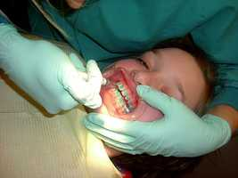 9: Orthodontists - $174,730