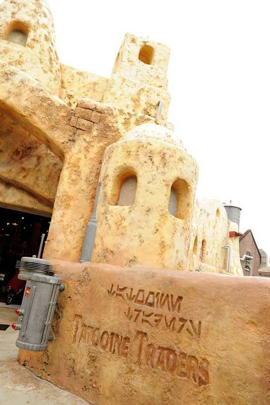 If you know the Imperial alphabet then you know the symbols spell Tatooine Traders.  The mystery image can be found there at Disney's Hollywood Studios.