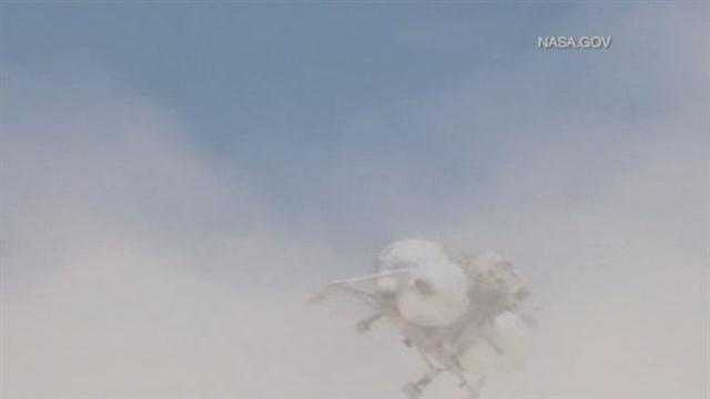 NASA video shows the spacecraft lifting a few feet off the ground before rotating sideways and crashing back to land five seconds later.
