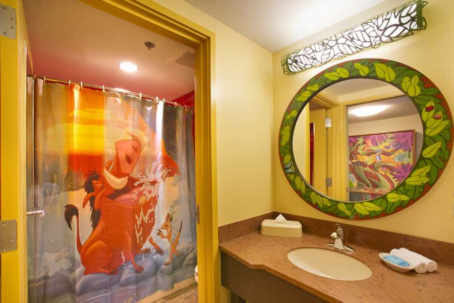 "The fun continues inside each of the 320 family suites in the ""Lion King"" area. Zazu decorates the headboard of each room, while Pumba and Timon appear on the shower curtain."