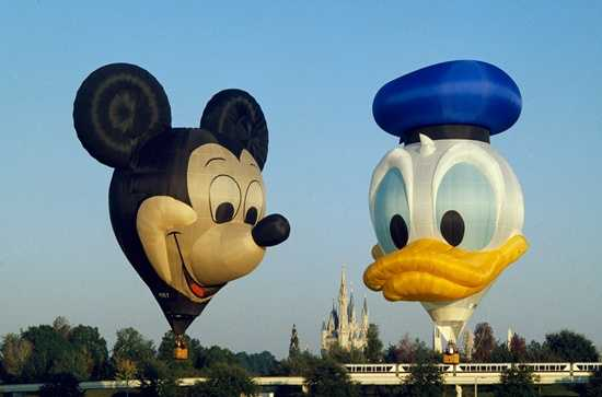 Mickey's ears are 32 feet in diameter and his nose is 30 feet long.  In 1988, Earforce One and Zip-a-dee-doo Duck took flight to kick off the New Year above the Disney Parks.