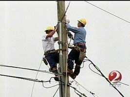 Crews work to restore power.