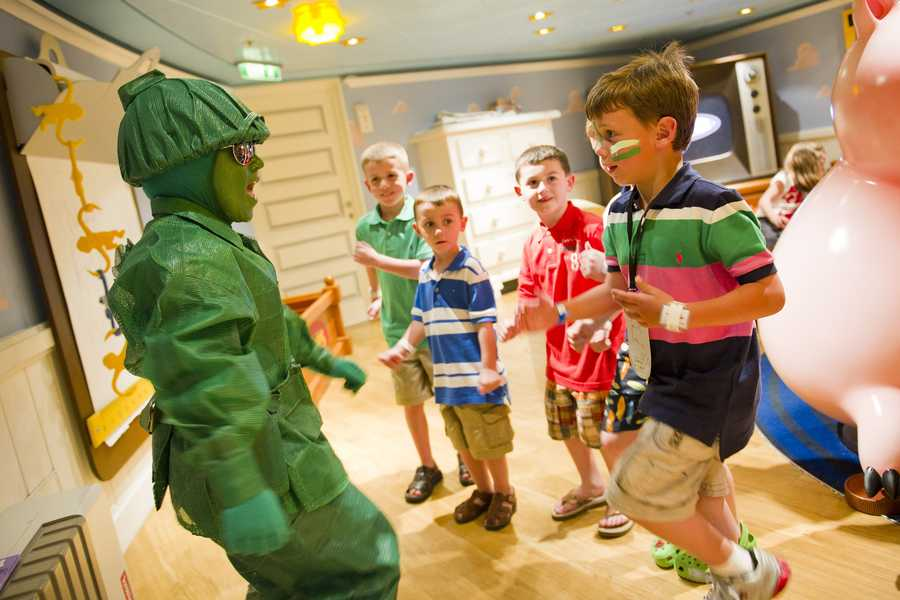 Characters such as the green army men make special appearances to recruit kids for hand-on fun and games aboard Disney Fantasy and Disney Dream.