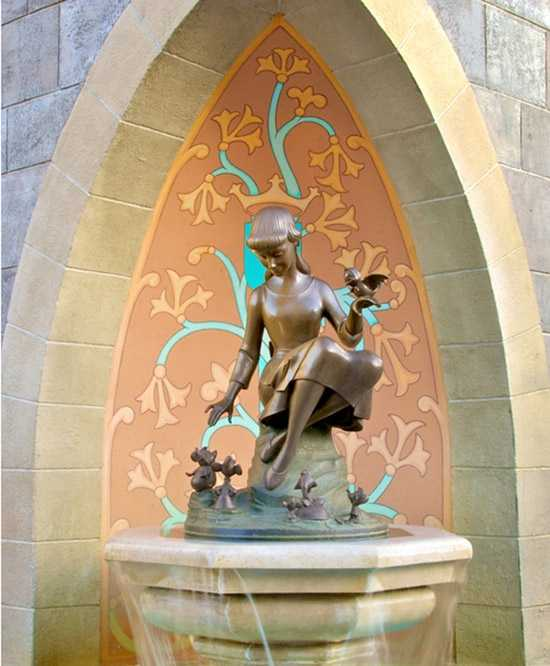 If you were quite observant you'd know that the crown is found behind a statue of Cinderella on a fountain near Fantasyland at the Magic Kingdom.  Disney officials say if you observe the crown from a child's point of view it fits perfectly on Cinderella's head.