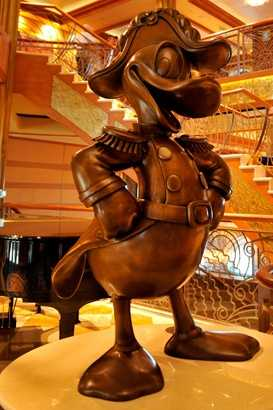 This Donald Duck statue oversees which Disney cruise ship lobby?