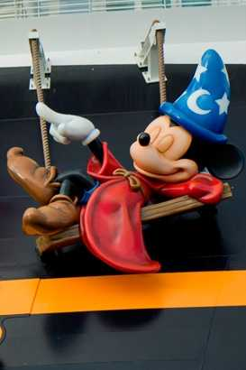 On which Disney ship can you see Mickey Mouse hanging out on the stern?