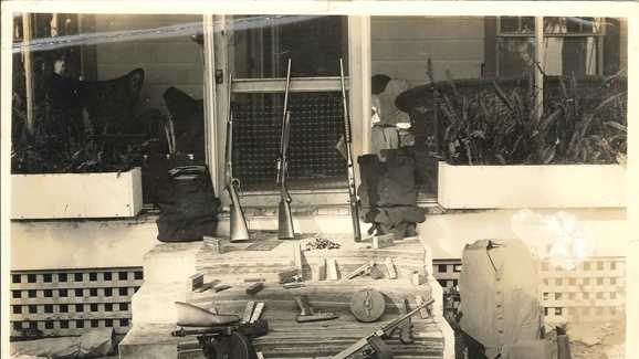 FBI photo of guns and ammo on front porch.jpg