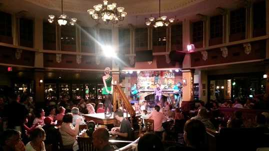 Six dancers perform at the pub.