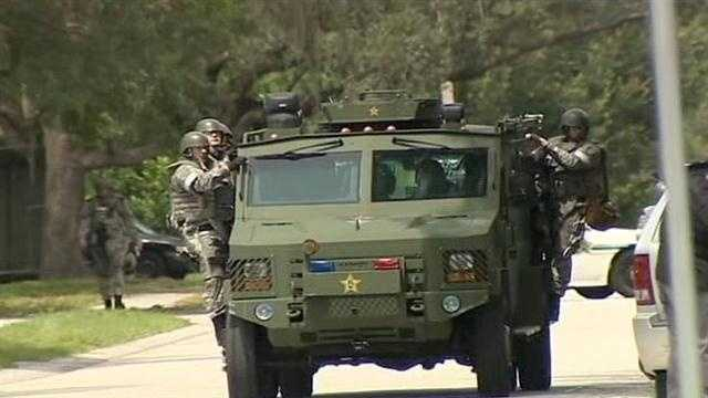 The Orange County Sheriff's Office was serving a warrant on a man when he barricaded himself in a home in Pine Hills.