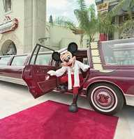 Only the best for the Mouse.  Mickey rides in style -- a stretched limo as it pulls up to the red carpet at Disney's Hollywood Studios.