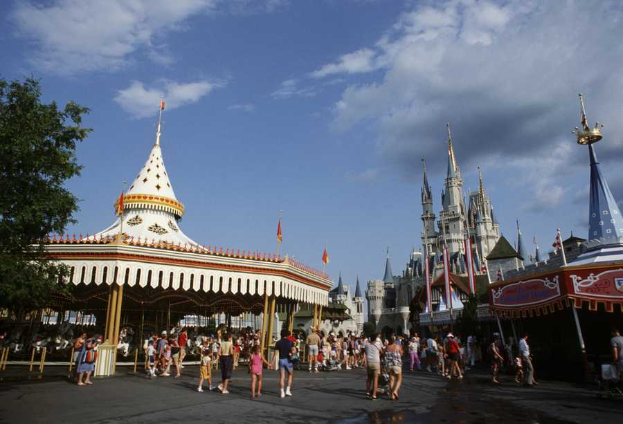 Disney's Magic Kingdom has seen some changes since its opening in 1971. See how some of the famous attractions looked in the past and how they look today. (Pictured: Cinderella's Golden Carrousel, which is now purple and named Prince Charming Regal Carrousel.)