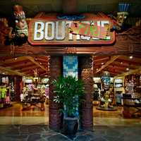 """If you frequent Disney's Polynesian Resort, then you know the bug-eyed Tiki sits overhead at the Bou-Tiki merchandise store.  The Tiki and several friends have taken control of the store and made some """"improvements"""" of sorts."""