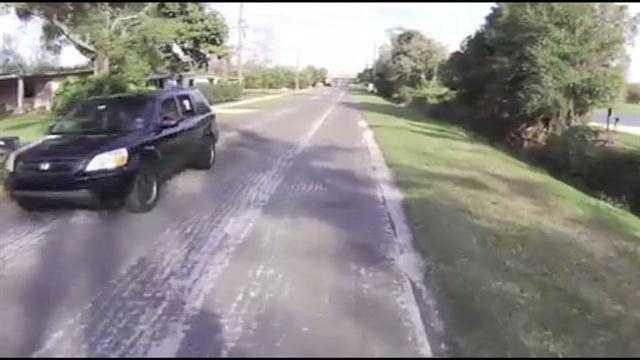 Raw Video: Cyclist gets hit with milkshake