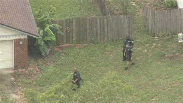 Orange County investigators search for a fleeing man who they believe is part of a burglary.