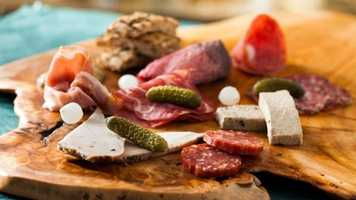 Charcuterie Plate - Assorted Cured Meats and Sausages served with Cornichons, Pickled Onions, and Toasted Whole Grain Bread