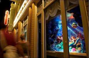 Did you get it right?  Ariel is apart of a series of six windows in the Emporium on Main Street, U.S.A.  The windows can be seen at both the Magic Kingdom and Disneyland Park.