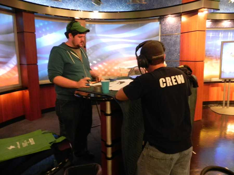 The crew gets ready for the next set of camera shots during a commercial break.