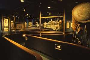 The queue at The Living Seas displayed artifacts and had a more nautical feel than Nemo's beach queue of the present.