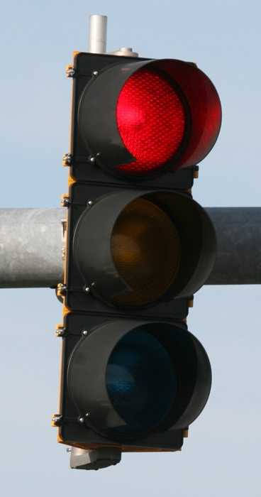15. After a full stop at a red traffic light, may a driver turn right if the way is clear?