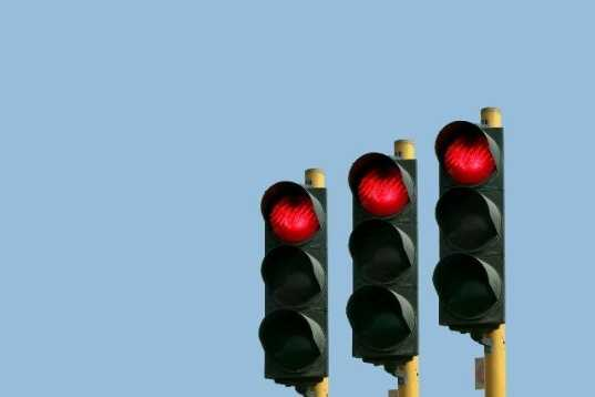 16. What does a flashing red traffic light mean?