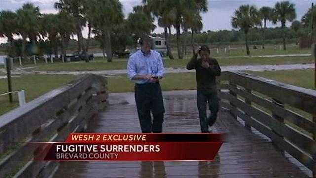 One of seven fugitives that fled from the Border Patrol into a swamp appeared in front of WESH 2 cameras Tuesday.