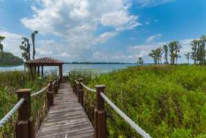 A private boardwalk allows access to 500 feet of frontage on Lake Butler with a dock.