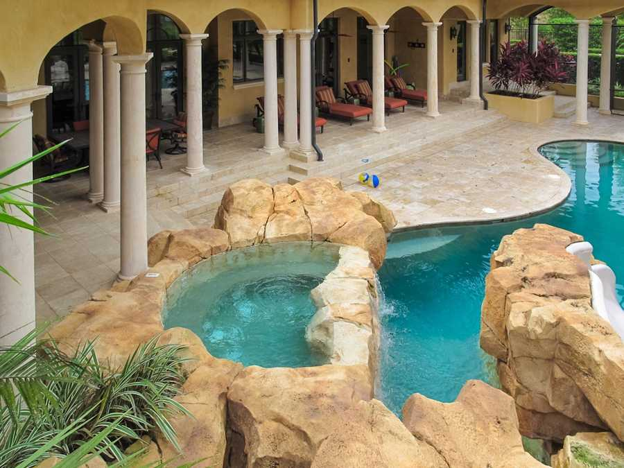 The resort-style swimming pool includes a waterslide and lazy river.
